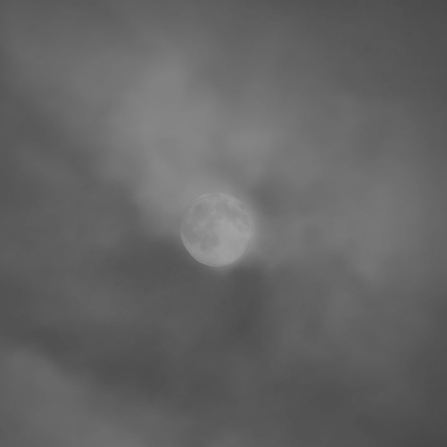 full moon hidden by clouds