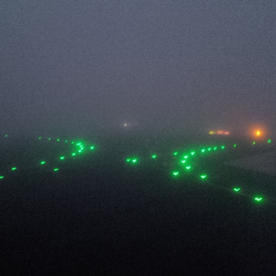 waiting for the plane on a foggy runway